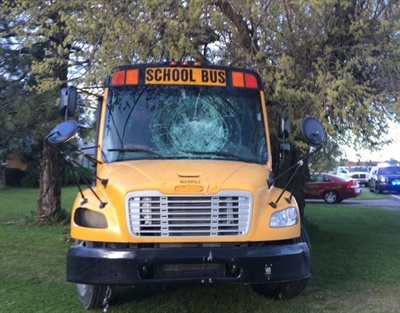 After a steering component failed, a Michigan school bus driver guided her bus, which had a cracked windshield that limited visibility, between two trees and brought it to a stop. Photo courtesy Tuscola County Sheriff's Office