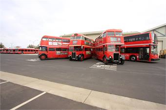 UC Davis' double-deck buses, shown from left to right: the RT 3123; RT 742; RTL 1014, and a modern Alexander Dennis.