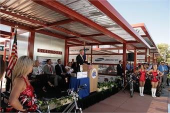 U.S. Senator Harry Reid (at podium), Governor Brian Sandoval, Samsung SDS, University of Nevada, Las Vegas (UNLV) and local, state and federal leaders joined RTC Southern Nevada officials to mark the grand opening of a new transit center located on the UNLV campus. Photo courtesy RTC Southern Nevada