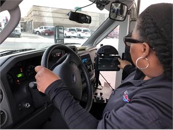 Utah Transit Authority paratransit operator Netta Jackson checks the new dispatching system. Photo: UTA