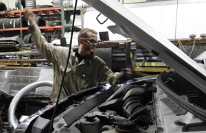 Sylvester Truck and Tire Service technician Joe Bury finishes an oil change.