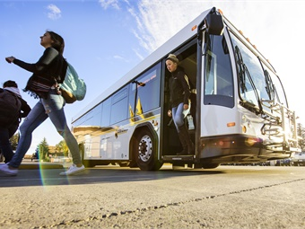 Students step off of one of UW's two new buses at the Wyoming Union lot. UW's transit service is available free of charge to students, employees and visitors. (UW Photo)