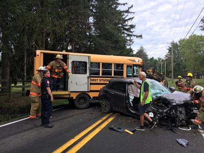 The First Student bus was transporting two studentswhen its passenger-side tires went off of the roadway,causing the driver to lose control of the bus and hit an oncoming vehicle. Photo courtesyLingohocken Fire Co.