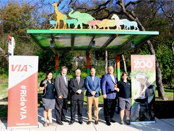 "(L to R) Kara Campbell, Animal Care Specialist, San Antonio Zoo (holding ""Twig""); Bob Comeaux, VIA Board of Trustees Member; Jeffrey C. Arndt, President/CEO, VIA Metropolitan Transit; Tim Morrow, CEO/Executive Director, San Antonio Zoological Society; A. David Marne, VIA Board of Trustees Member; Sara Escobedo, Animal Care Specialist, San Antonio Zoo (holding ""Cindy"")"