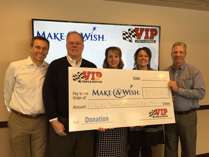 Employees and customers raised more than $55,000 for Make-A-Wish in VIP Tires' Season of Wishes campaign. Make-A-Wish Executive Directore Kate Vickery is in the center with VIP Tires employees (from left): Tim Winkeler, president and chief operating officer; John Quirk, chairmanand CEO; Mary Daigle, operations office manager; andGary MacCausland, vice president of operations.
