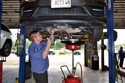In Portland, Maine, a technician changes the oil on a customer's vehicle. VIP has created seven-step paths for every technician and service advisor to move up and make more money.