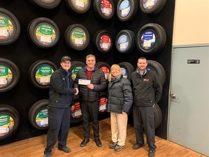 The Westbrook, Maine, store handed its donation to Westbrook school officials. From left, VIP Service Manager Matt Brown; school Superintendent Peter Lancia; Nutrition Director Mary Emerson and VIP Market Manager Shane Clukey.
