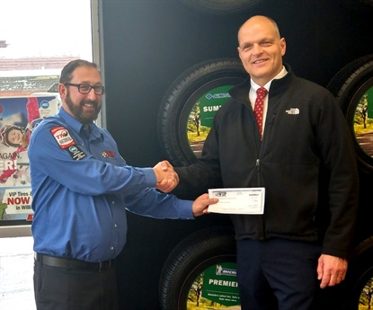 VIP split the $6,070 it raised from an oil change promotion between two local school districts. Boundreau presents a check to Hartford Schools Superintendent Thomas Debalsi.