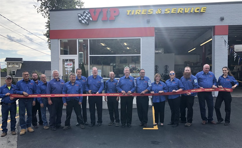 Employees at the new VIP Tires & Service store in West Lebanon, N.H., prepare to cut the ribbon at a grand opening ceremony on Aug. 23.