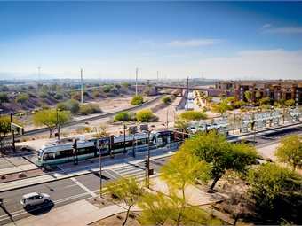 Valley Metro's 28-mile light rail system supports job growth and community-wide health benefits, while also generating investment. Valley Metro