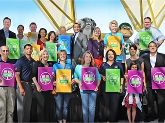 Just before the first, official train departs 19th Ave/Dunlap, local officials and community members celebrate their new service by holding We are 19th Ave signs. Top row, first from left, Phoenix Mayor Greg Stanton; seventh from left, Phoenix Councilmember Daniel Valenzuela; eighth from left, Phoenix Vice Mayor Kate Gallego; far right, Valley Metro Interim CEO Scott Smith.