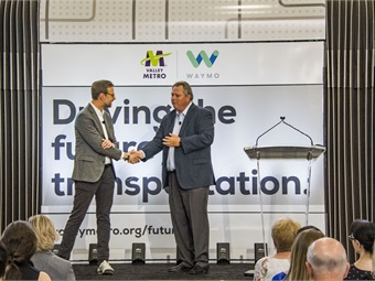 Shaun Stewart, Waymo Chief Business Development Officer and Scott Smith, Valley Metro CEO shake hands over forging a new partnership that will help drive the future of transportation. Photo: Valley Metro