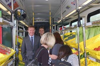 "Valley Metro Chair and Mesa Councilmember, Scott Somers (left), with ""passengers"" aboard the Fresh Express bus."