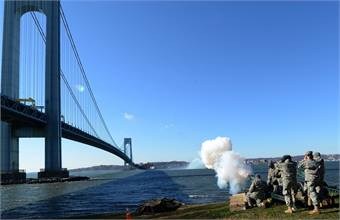 As part of the commemoration of the 50th anniversary of the opening of the Verrazano-Narrows Bridge, the Veteran Corps of Artillery fired a 50-gun salute, with howitzers on both the Brooklyn and Staten Island sides of the Narrows. Photo: Marc A. Hermann / MTA New York City Transit