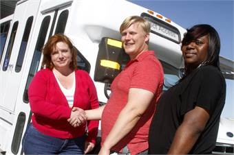 Midge Nicosia, VVCSC executive director, left, and Dyesha Sanders, VVCSC program manager, right, receive delivery of the VVTA-donated paratransit bus by VVTA Mobility Manager, Aaron Moore, center. The VVCSC New Freedom Program begins service to senior citizens and people with disabilities on April 25.