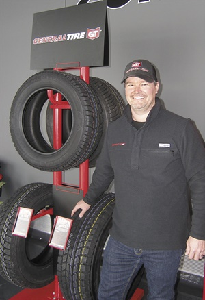 Travis Roffler, director of marketing for the General brand, is next to a display of the brand's winter lineup of Grabber Arctic, Grabber Arctic LT and Altimax Arctic 12 tires.