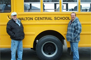 Mac Dann (left) and Dave Edwards helped evacuate residents in Walton, N.Y., before the city was flooded in September. Dann has worked for Walton Central School District as a sub driver for five years, and Edwards has been a full-time driver for three years.