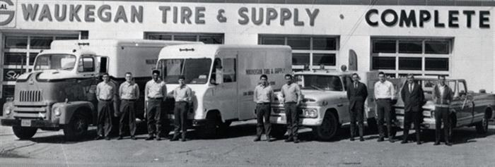 Jerry Nerheim (fourth from right) and employees stand outside the original Waukegan Tire store in 1969 at SW corner of Jackson Street and Belvidere Road in Waukegan, Ill. Photo courtesy of Waukegan Tire.