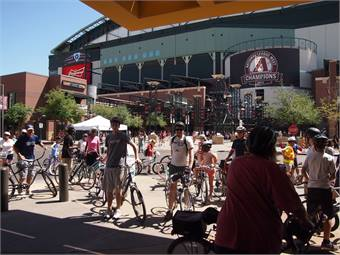 Great Bike Chase riders arrive for events at ballpark on Earth Day.
