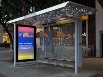 "The city of West Hollywood, California's, new ""smart"" bus shelter incorporates an ADA Wheelchair Zone and its ambient ceiling lighting was designed to look as if standing underneath a leafy tree canopy.