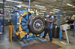 Harry Lyons wraps a retreaded tire at Carolina Retread, where production has grown significantly since Black's Tire acquired a retread business in 2007, from seven tires a day to 225.