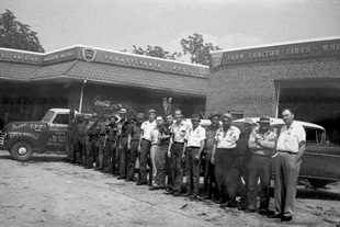 This original Black's Tire store remains in operation in Whiteville, N.C. The company's founder, W. Crowell Black, is pictured at the far right in this photo from the 1950s.