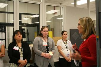 Trisha Jackson, Technical Operations Manager at the Potomac TRACON and Air Traffic Control Systems Command Center, leads a group of girls and their mentors on a behind-the-scenes tour.