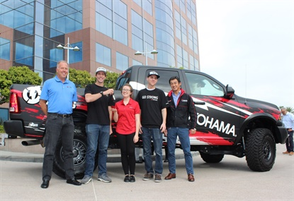 Nitro Circus co-founder Travis Pastrana hands the keys to Becca Panelly and her husband Jeff, right. They're picturd with Yokohama President Shinichi Takimoto, far right, and Yokohama Chief Operating Officer Jeff Barna, far left.
