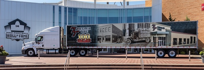 To raise the public's awareness of its 100th anniversary, Ziegler Tire wrapped one of its trucks in graphics with images from its past. The truck is at the site of the company's anniversary celebration, the Pro Football Hall of Fame. (photo courtesy Ziegler Tire.)