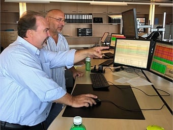 Paul Comfort (left) receiving an overview of the technology at the Zurich Transit System's (VBZ) Operations Control Center from one of their managers.