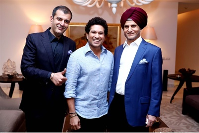 Former cricket player Sachin Tendulkar, center, is flanked by Apollo's Neeraj Kanwar, left, and Onkar Kanwar.