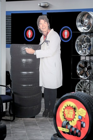 """The face of Dr. Tire in Dallas, a fictional tire dealership on The Big Bang Theory episode, """"The Sibling Realignment,"""" is actor Jerry O'Connell, complete with a white lab coat. """"This business isn't too conducive to lab coats being white!"""" says Joe Bostick, president of Dr. Tire Inc., a real dealership in Estill, S.C. Courtesy of Warner Bros. Entertainment Inc. © 2018 WBEI. All rights reserved. Photo by Michael Yarish."""