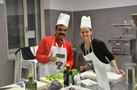 Erin Edminister, right, assistant marketing manager for BKT USA Inc., and Sandesh Jain general manager, exports for BKT in Mumbai, India, worked in the same group to cook one course for the group meal. Each course was prepared by a different group.