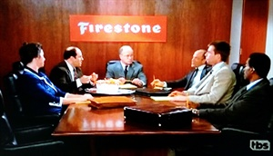 George Costanza had to fly into Akron, Ohio, to meet with Firestone executives. (Screen capture from TBS)