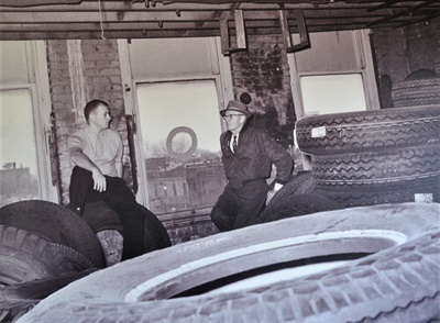 Benjamin J. Geiger, right, founded Capital Tire in 1919. He is pictured with his son, Tom Geiger, at the warehouse in 1955.