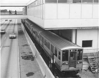 <p>A train of Lake-Dan Ryan All-Stop 2200's are heading southbound into 95th Street, finishing their run, looking north from the 95th St. bridge in 1973. Photo courtesy Chicago