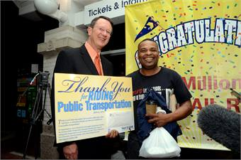 DART President/Executive Director Gary Thomas(left) with the agency's 250 millionth rail rider Don Johnson.