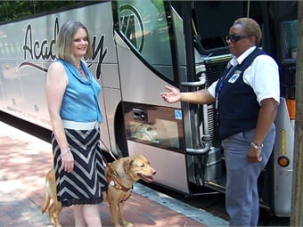 Donna Smith and Farlow with driver and motorcoach. Photo used with permission from Donna Smith's personal collection.