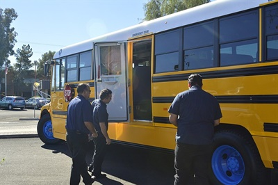 School Transportation Staff Check Out The Composite Side Panels And Bus  Interior.