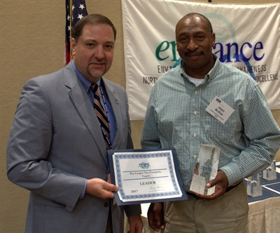 Albert McShan (right), energy coordinator for Cooper's Tupelo plant, accepts the enHance Leader award from Mississippi Department of Environmental Quality Executive Director Gary Rikard.