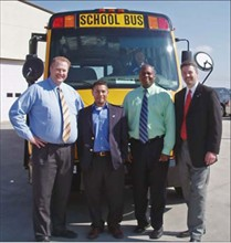 As part of the Love the Bus campaign, (from left) Brian Shuldberg, Gus Rodriguez and Robert Hatchett of Durham and Allan Haggai of Thomas Built Buses hosted an employee appreciation event at Durham's McKinney, Texas, branch.