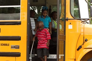 Pupils disembark a bus operated by First Student in Jefferson Parish. The contractor began providing service for the parish after Katrina because of a shortage of bus owner/operators.