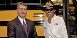 Thomas Built Buses President John O'Leary (left) poses with racing legend Richard Petty, who made a special appearance at the Thomas exhibit during the National Association for Pupil Transportation's trade show in Austin in November.