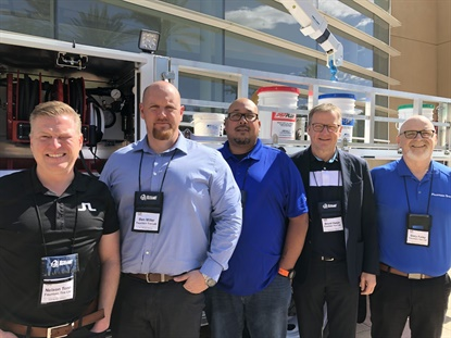 Fountain Tire was well-represented during the OTR Tire Conference. From left to right: Nelson Tonn, vice president of sales and mine service; Ben Miller, director of mining operations; Darren Chalifoux, director of OTR safety and equipment; Fountain Tire CEO Brent Hesje; and Gary Foley, director of store OTR operations, in front of a Stellar Industries service truck.