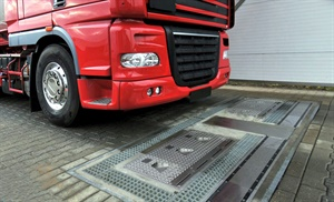 Ventech's a fully-automated tire inspection system checks tire pressure, tread depth and vehicle weight as the buses, trucks, cars and other vehicles drive over the measuring device.