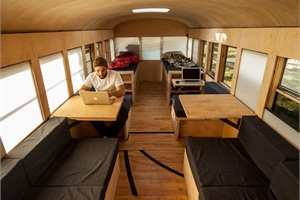 Hank Butitta bought an old school bus for $3,000. With about 15 months of work and $6,000 in improvements, the bus became a mobile living space. Photo by Justin Evidon