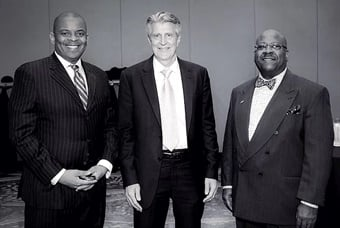 As president of the Council of University Transportation Centers (CUTC), Joel served as the master of ceremonies for the CUTC Annual Awards Banquet in 2016. Here, Joel stands beside the keynote speaker and former USDOT Secretary Anthony Foxx (left) and Greg Winfree (right), former U.S. Assistant Secretary of Transportation for Research and Technology. Photo courtesy of Joel Volinski.