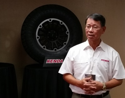 Kenda USA President Jimmy Yang introduces the Vezda Touring A/S and Klever R/T in Las Vegas.