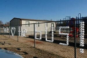 "Last year, Norman Public Schools students honored bus drivers and monitors by spelling ""We love the bus"" with Styrofoam cups on a fence where the buses pull up to a school."