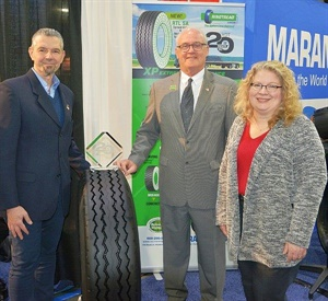 Giampaolo Brioschi, left, director of research and development forMarangoni SpA, and Bill Sweatman, president of Marangoni Tread North America, received a Top 20 Products Award from Deborah Lockridge, editor of HDT.